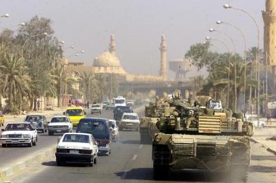 Two U.S. Marine Corps M1 Abrams tanks patrol the streets of Baghdad, Iraq (Wikimedia)