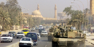 Two U.S. Marine Corps M1 Abrams tanks patrol the streets of Baghdad, Iraq (Wikimedia)